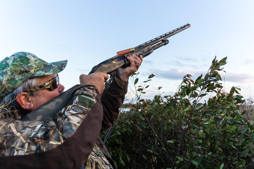 Man Shooting Ducks with Gun