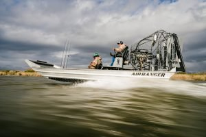 Air boat at speed with captain and passengers | Bay Flats Lodge | Texas Airboat Fishing